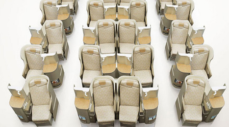 1-2-1 configuration in Business Class.  We had so much room.  For the center seats, there is a panel that you can pull up to give you some separation from your seat mate.