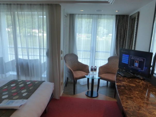 Stateroom with an open balcony that you could sit on as well as a French balcony