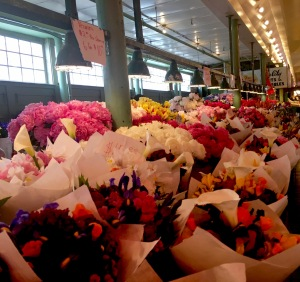 Rows and rows of beautiful floral bouquets many featuring peonies and irises
